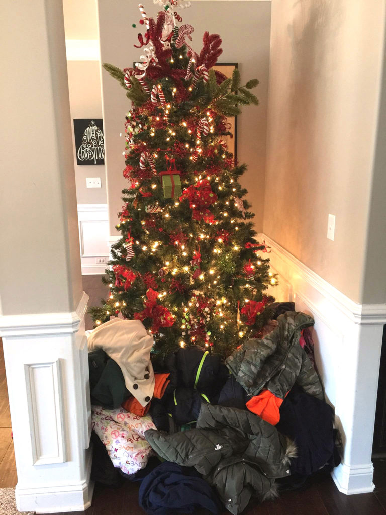 Walbridge Southeast Get Work Director Joey Smith and his wife, Lindsay, welcomed colleagues from the Charlotte office to their home in Waxhau, NC, for a holiday party. It was part celebration and part coat drive. The WSE team contributed 51 coats to be given out to local schoolchildren in need.