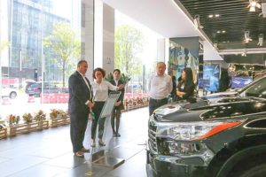 Mark McClelland and Delphine Grattan tour a facility in China