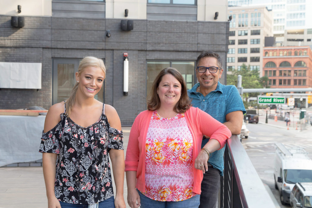 The 28 Grand project team, (l-r) Samantha Russo, Kristie Bieniewicz and Dominic Pizzo, enjoy the moment as the downtown Detroit project wraps up.