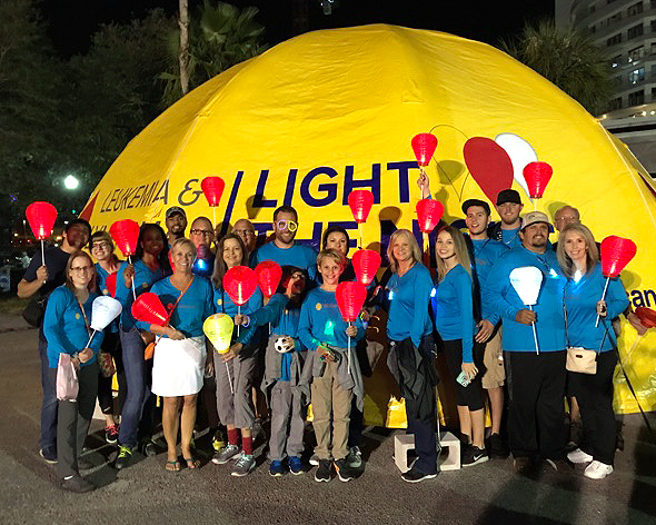 Members of Walbridge's Florida Group gather for the Leukemia & Lymphoma Society's Light The Night Walk on Nov. 18 in Tampa. Money raised by the event funds treatments that save lives. The Walbridge squad, captained by Frank Rygiel (wearing the purple and green glasses), raised $10,300, making them the third-ranking corporate fundraising team.