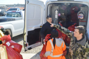 Dave Robson, Walbridge Vice President and Community Engagement Officer for the Microsoft Data Center build in Boydton, Virginia, lifts gifts out of the back of a van in support of the MCDSS 2018 Christmas Program.